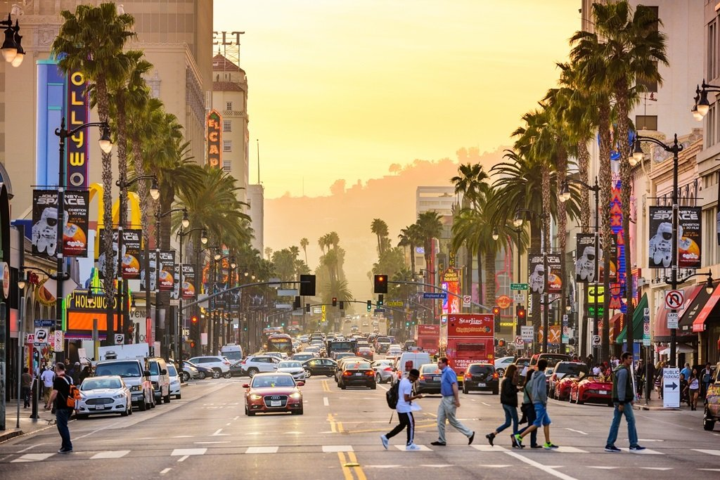 LOS ANGELES, CALIFORNIA - MARCH 1, 2016: Traffic and pedestrians on Hollywood Boulevard at dusk. The theater district is famous tourist attraction.; Shutterstock ID 434708779; Departmental Cost Code : 162800; Project Code: GBLMKT; PO Number: GBLMKT