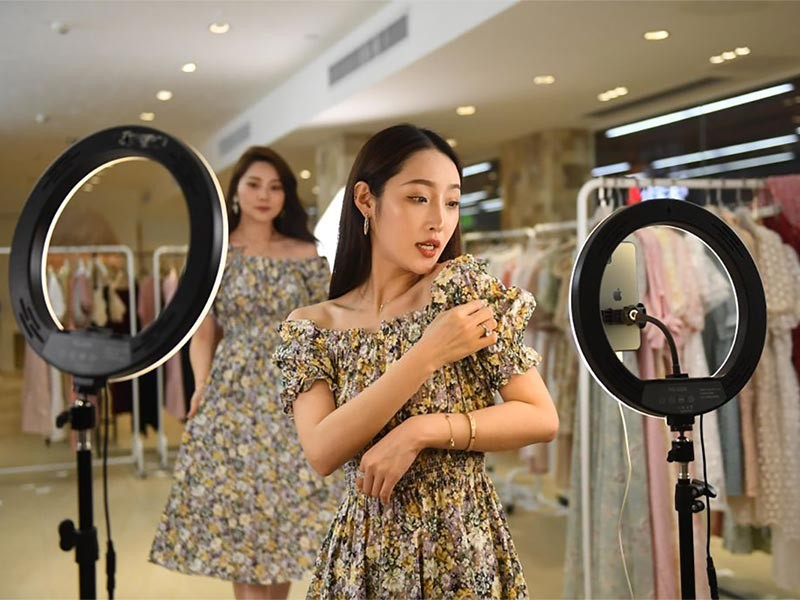 Models trying dresses in Retail Stores
